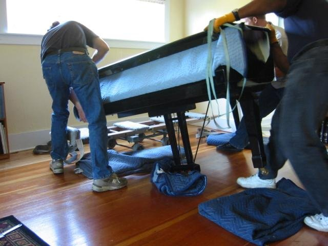 leg removed piano set on moving board