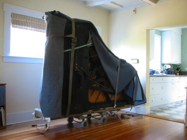 Piano wrapped and strapped ready to load